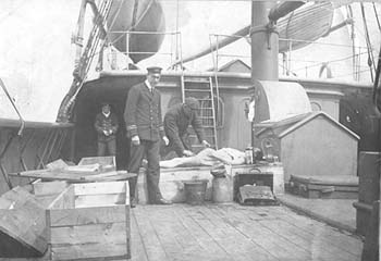 Preparing bodies aboard the cable ship Minia