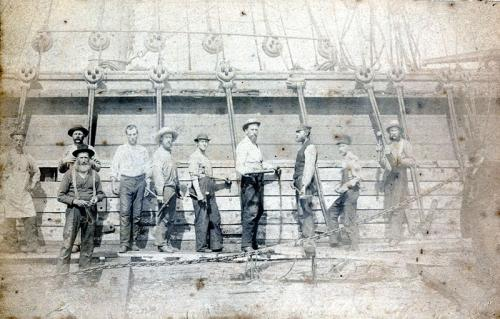 MP300.3.1: Caulkers at work at the Ebenezer Cox Shipyard, Kingsport, NS, around 1890.