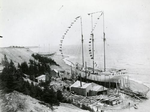MP9.229.1: Tern schooner Irma Bentley under construction at Elderkin shipyard, Port Greville, NS, 1908, with two unidentified vessels in background.