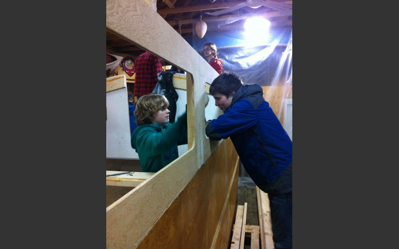 Local boy Scouts lend a hand sanding off some rough edges
